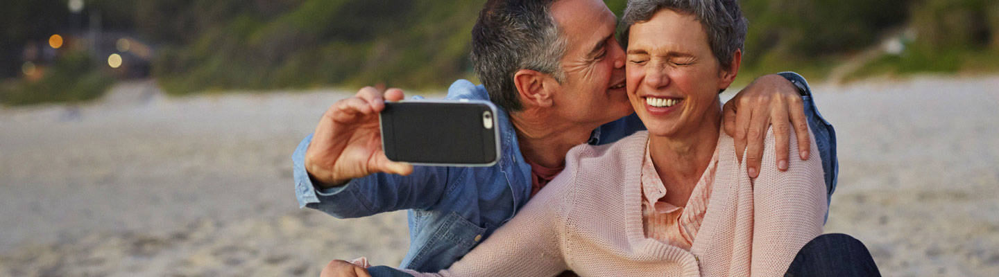 Couple taking selfie on beach