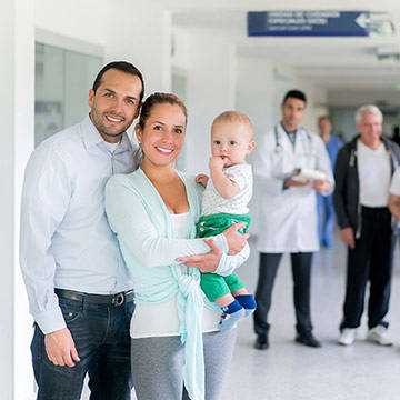 family-standing-in-hospital