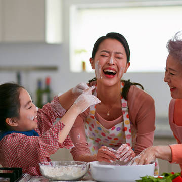 3 generation women laughing while baking