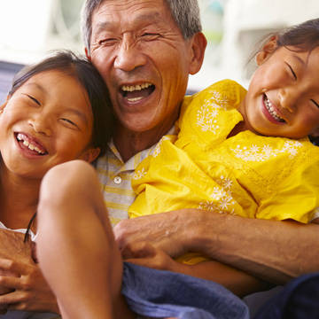 Family laughing and playing together