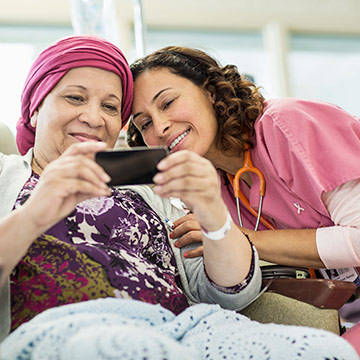 cancer-patient-and-doctor-looking-at-phone