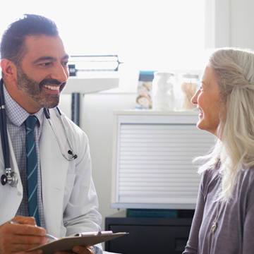 Female patient consulting with male doctor