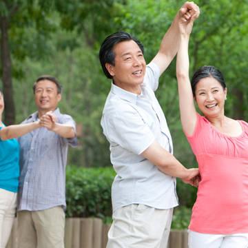 Asian couples dancing at park