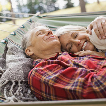 Senior couple relaxing on hammock