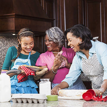 Grandmother, mother, young girl baking a pie