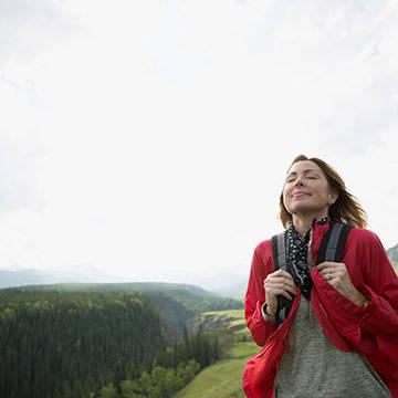 woman hiking breathing air