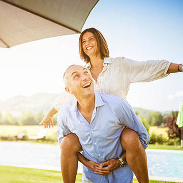 Mature Couple Enjoying Sunny Weather